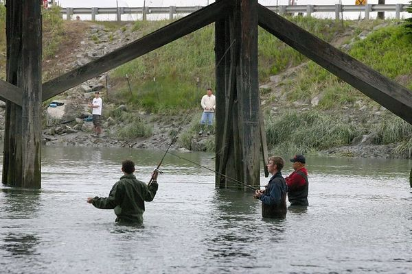 A trio of anglers work the 'hole' between the bridges.  This hole can be difficult to fish due to the bridge supports.  Once a fish is hooked, the fish can easily entangle the line in the bridge pilings, breaking the line or worse. Skill is important, but luck can play a significant role in landing a fish here.