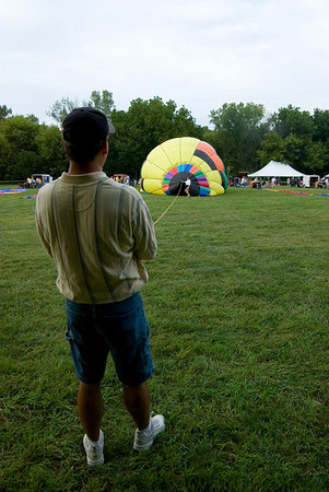 "<font size=""3"">It takes a while to get something this big filled with hot air.<br><br>All of the team members took part in keeping the balloons under control during inflation.</font>"