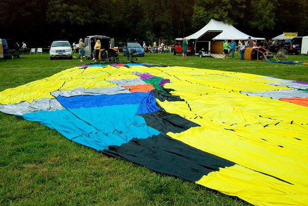 """<font size=""""3"""">The first group of a dozen or so balloons were spread out on the field by their teams.  Once finished with this task, the teams waited permission to continue.</font>"""
