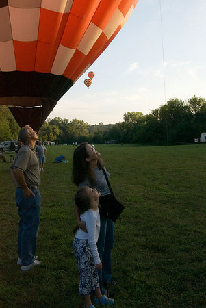"""<font size=""""3"""">After the last of the balloons were in the air, the crowd was allowed on the field to get a closer look.</font>"""