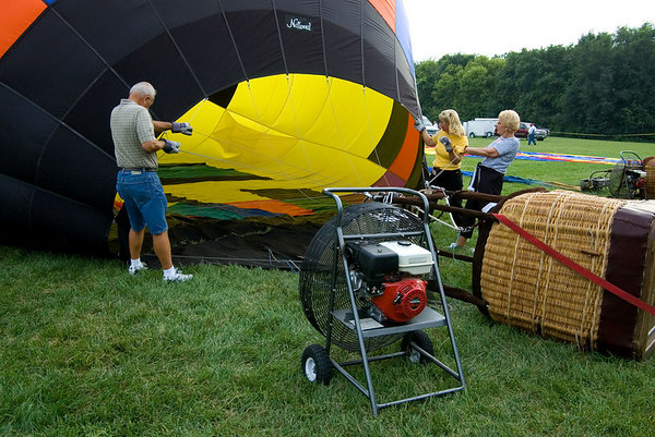 "<font size=""3"">Teams start the the inflation process by blowing air into the balloon with a large fan.</font>"
