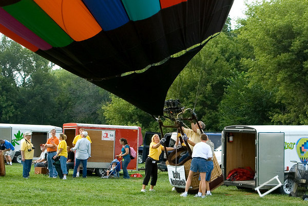 """<font size=""""3"""">When the air is hot enough it begins to lift the balloon.<br><br>The pilot regulates the temperature to keep the baloon upright, but cool enough to stay on the ground.<br><br>The other team members help keep things under control.</font>"""
