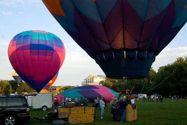 """<font size=""""3"""">As the sun set, the pilots fired their burners so the crowd could see the balloons glow.</font>"""