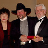 Donna Poy (Horsewoman of the Year) and Ernst Meissner (Horseman of the Year) pose with Al Filice (SMCHA's President).