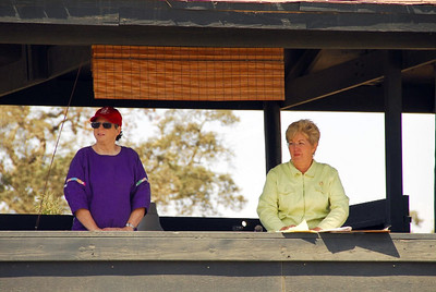 Ann Farris, SMCHA's Membership Chairman, assists the Bay Arena's announcer Cheryl Basin, SMCHA's 2nd Vice President.