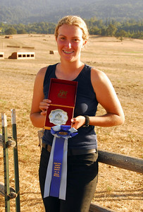 Danielle Bushue proudly shows her First Place Ribbon and Trail Class Buckle.