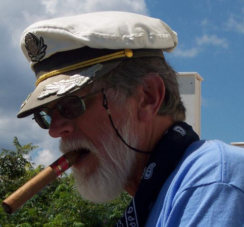 And another cigar, wait a minute, Captain John is a non-smoker. Okay, its not lit!