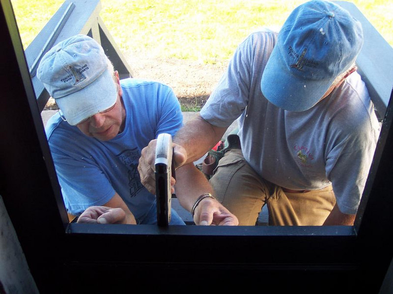 Peter and Dick working on the Assistant Keepers back porch door.