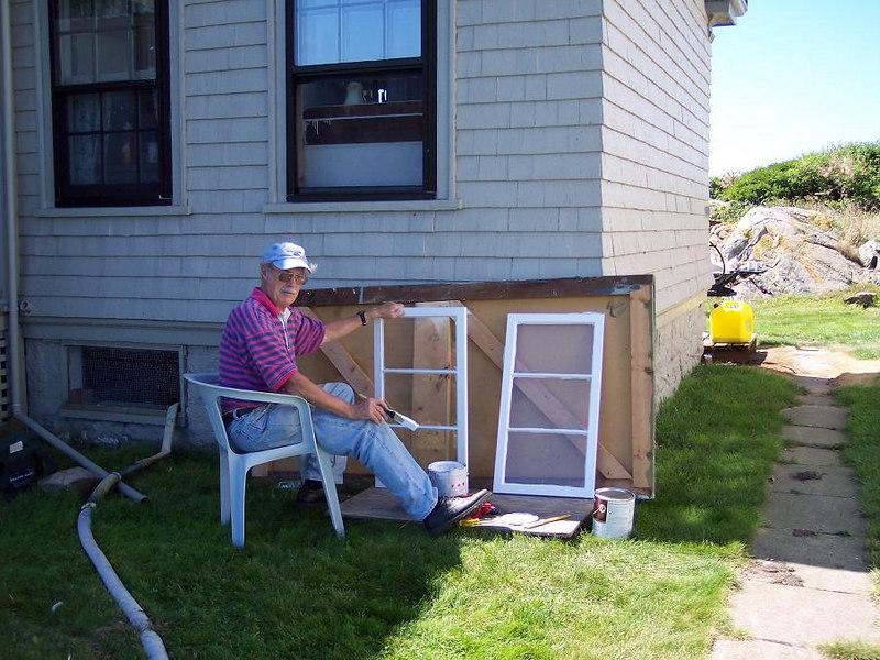 Painting window trim for John.