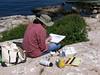 Artist on the rocks.