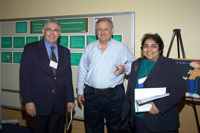 Dr. Raymond Rodriguez with professor Craig Warden and Dr. I. Sadaf Farooqi, symposium speaker in the poster display area.