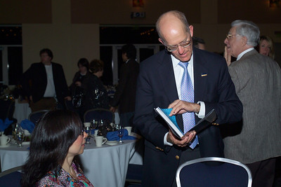 Dean Ken Burtis looking at Ms. Isabel Cruz's latest cookbook, Isabel's Cantina.