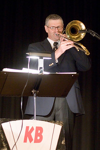 Tenor trombonist Ray Olson of the jazz group Kickin' Brass performs at the Belvidere Community Center during the Boone County Council on Aging's annual black and white gala on Saturday night.
