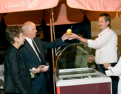 Sally and Bud Rode of Belvidere (left) get desserts of lemon gelatto from Greg Sandahl of Cannoli Caffe during the Belvidere Community Center during the Boone County Council on Aging's annual black and white gala on Saturday night.