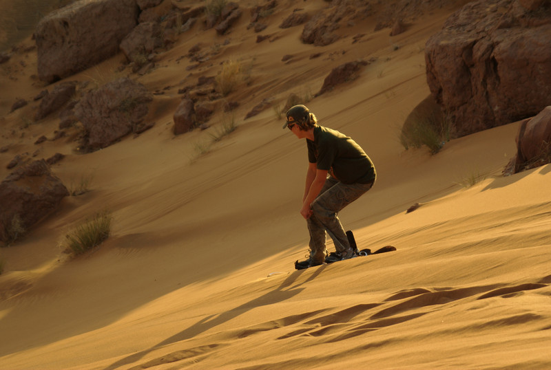 My sister, doing the dune boarding thing! She's braver than me, and I am happy being on this end of the camera.