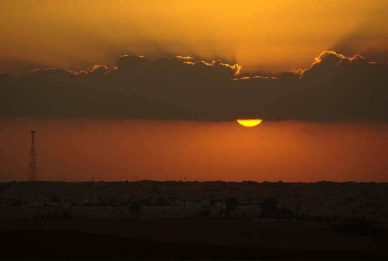 Sunset over the desert in Sharjah, UAE.