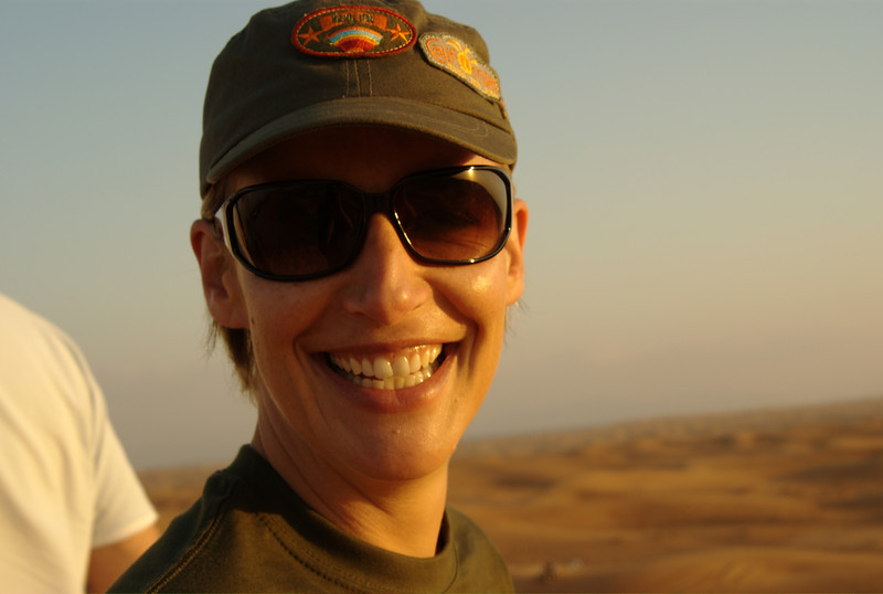 My sister, standing at the top of a dune, in the Arabian deserts of the UAE.