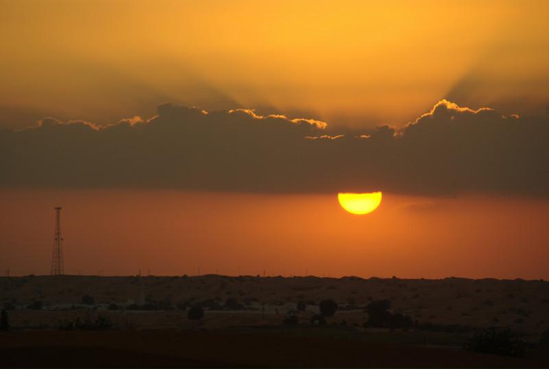 Sunset over the desert in Sharjah, UAE.