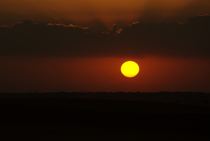 Sunset over the UAE desert, in the desert of Big Red.