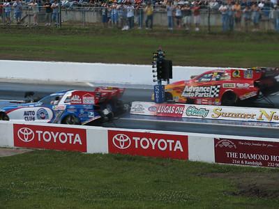 Robert Hight and Cruz Pedregon funny cars leaving start line