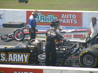 Alan Johnson tuning Tony Schumacher's dragster. Starter Rick Stewart in background