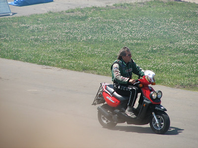 John Force riding scooter