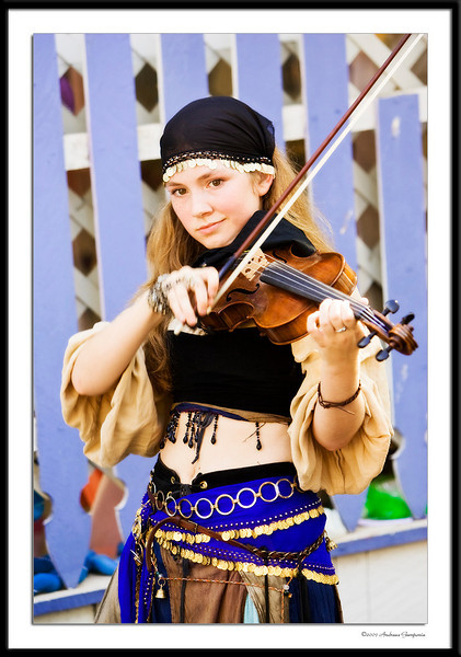 Sweet gypsy music....these sounds combined with that slight smile may prove more alluring than the scents from the mysterious sorceress.