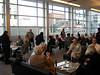 Alumni reminiscing in the Duncan Pavilion at the Denver Art Museum.