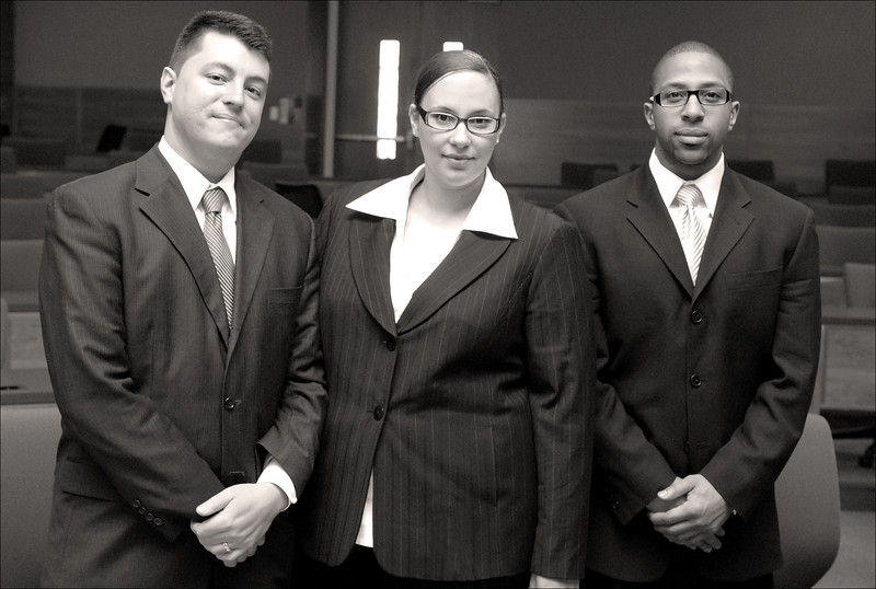"""The defense team: Adrian Madrone and Karama Hawkins with their """"client""""."""