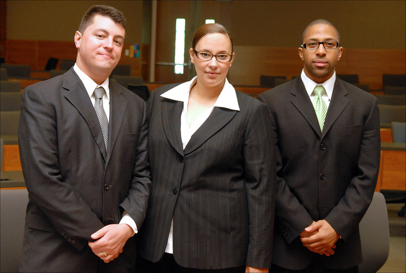 "The defense team: Adrian Madrone and Karama Hawkins with their ""client""."