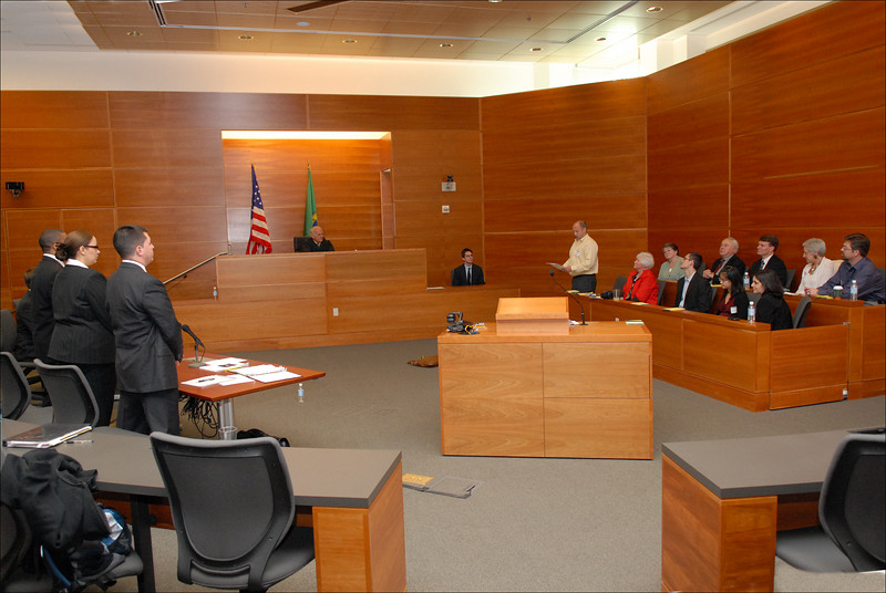 The jury foreman presents the verdict.