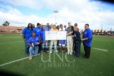 Phi Beta Sigma donates a check at the UNCP Homecoming Game in Pembroke, NC on October 6th, 2007 webber_0115.JPG