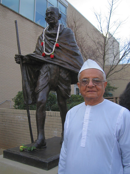 Thakorbhai Parekh by Gandhi's statue, Exploris Courtyard, Raleigh 3