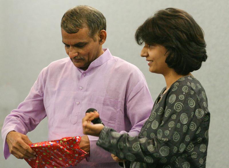 20070805 Neesha presenting the book to Prakash Amte