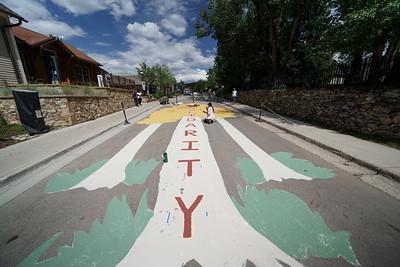 Latasha Dunston paints The Solidarity Street Mural at the Breckenridge Arts District in Breckenridge, Colorado
