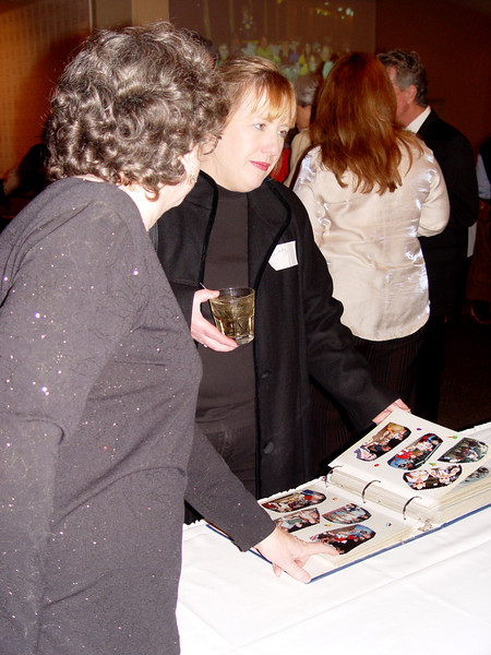 Ann Farris & Libby Kurtz flip through one of the many SMCHA photo books
