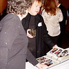 Ann Farris & Libby Kurtz flip through one of the many SMCHA photo books