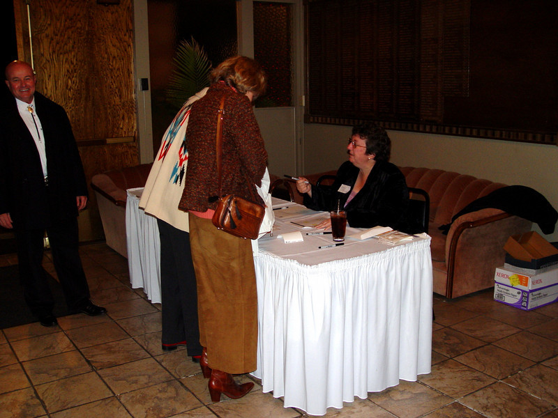 Ginger Bushue (newly elected 2008 Board member) checks incoming guests
