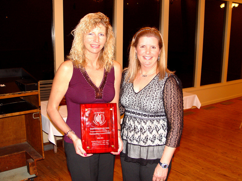 2007 President, Sarah Filice, honors Tanya Rebarchik with the Outstanding Contribution Award -- in appreciation of her many years of service as Board of Director from 1995 to present, Magazine Editor from 1997 to present and recipient of Horsewoman of the Year in 2003.