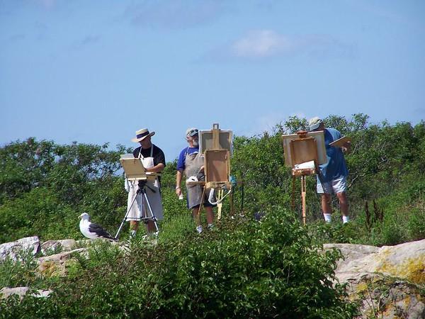 Trio painters on the rocks.