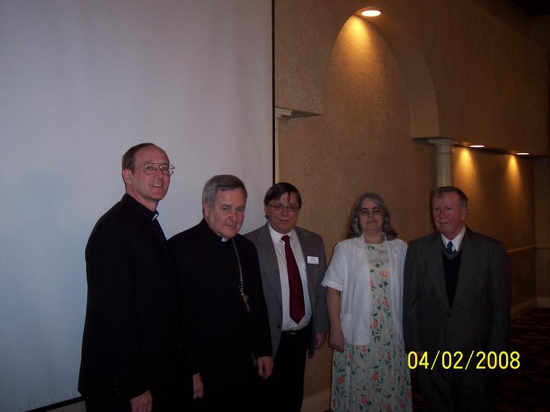 L-R:  Fr. Ed Fride, Bishop Carlson, Bernie Coppolino, Marian Moll and John Moll