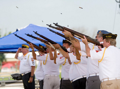 Members of the American Legion Post 77 and the Veterans of Foreign Wars post 1461 fire a ceremonial volley of rifle fire during the official opening of the 2008 Boone County Fair on Tuesday, August 5.