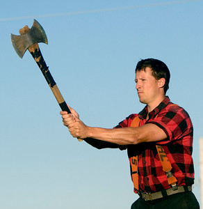 Andrew Johnson of Alaska takes aim at a target as part of the Scheer's Lumberjack show during the Boone County Fair on August 7.