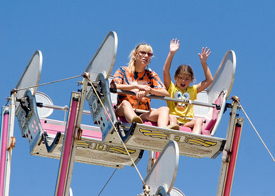 Donna Leff, 17 (left) and Chloe Jeffries, 7, both of Loves Park, enjoy a ride on the Ferris wheel at the Boone County Fair on Sunday, August 10.