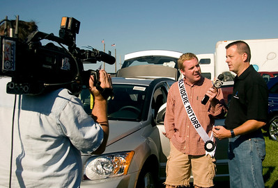 Aaron Wilson of WIFR TV-23 in Rockford interviews Gary Dixon of Belvidere Motors about the Dodge Caliber SXT, which is manufactured at the Belvidere Chrysler plant.  Wilson is wearing the Belvidere Motors sash in observance of Belvidere Motors' sponsorship of Nikole Goeddeke, who was crowned the 2008 Miss Boone County Fair queen on Tuesday night.
