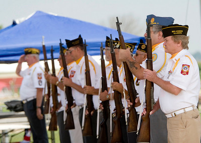 Members of the American Legion Post 77 and the Veterans of Foreign Wars post 1461 present arms during the official opening of the 2008 Boone County Fair on Tuesday, August 5.