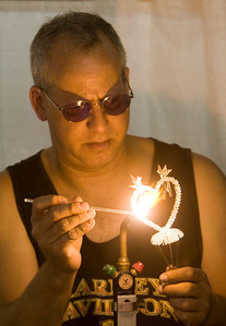 John McElmeel of American Glass Craft in Ridot crafts a glass ornament at his booth at the Boone County Fair on Friday, August 8.