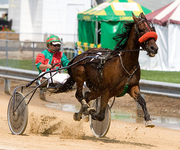 George Conley of Capron rides his horse Victory Stein during the fifth race of the horse and harness races at the Boone County Fair on Tuesday, August 5.