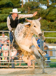 Eric Hopp of Revere, MO stays on his bull during the bull-riding competition at the Boone County Fair on Tuesday night.