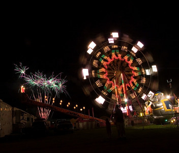 Fireworks burst in the air behind the Ferris wheel following the Blake Shelton concert at the Boone County Fair on Saturday, August 9.